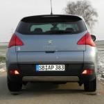 Die Heckpartie des ersten Diesel-Hybrid-Fahrzeuges Peugeot 3008 Hybrid4