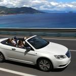 Lancia Flavia Cabrio in Weiss (Fahraufnahme)