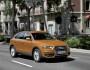 Audi Q3 bei der Fahrt in orange