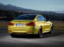 2014er BMW M4 Coupé in gold in der Heckansicht