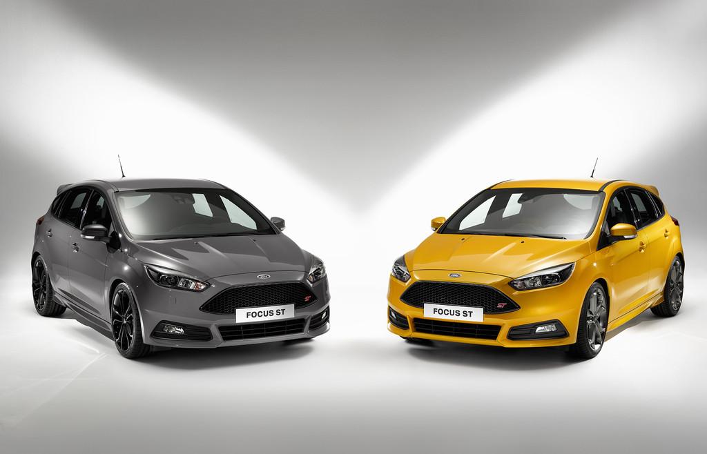 Der Ford Focus ST Facelift 2015 in schwarz und orange auf 19 Zoll Felgen