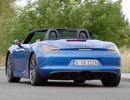 Blauer Porsche Boxster GTS 2014 bei einer Probefahrt