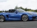 Fahraufnahme von einem blauen Porsche Boxster GTS